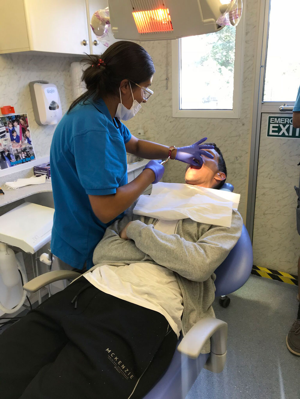 Dentist Nafiza treating a patient for Kitchen for Everyone York